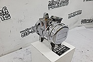 Aluminum AC Compressor AFTER Chrome-Like Metal Polishing and Buffing Services / Restoration Services - Aluminum Polishing - AC Compressor Polishing