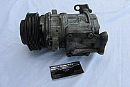 Ford Mustang Aluminum AC Compressor BEFORE Chrome-Like Metal Polishing and Buffing Services