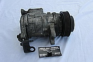 Ford Mustang Aluminum V8 AC Compressor BEFORE Chrome-Like Metal Polishing and Buffing Services