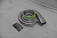On 3 Performance Aluminum Turbo Housing BEFORE Chrome-Like Metal Polishing and Buffing Services - Aluminum Polishing