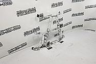 Aluminum Hood Mount Brackets AFTER Chrome-Like Metal Polishing and Buffing Services - Aluminum Polishing