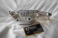 Aluminum Power Steering Pump Bracket BEFORE Chrome-Like Metal Polishing and Buffing Services / Restoration Service