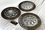 Harley Davidson Aluminum Brake Rotor Centers BEFORE Chrome-Like Metal Polishing and Buffing Services / Restoration Services