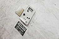 Nintendo Gameboy Aluminum Cover BEFORE Chrome-Like Metal Polishing and Buffing Services / Restoration Services - Aluminum Polishing