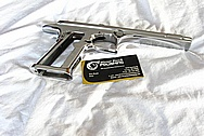 Magnum Research DE 44 Mag Stainless Steel Gun Frame, Slide, Barrel, Sights, Safeties, Slide Stop, Hammer, Take Down Release, Magazine Catch, Pins and Screws AFTER Chrome-Like Metal Polishing and Buffing Services