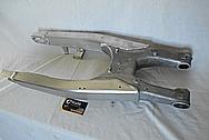 Aluminum Motorcycle Swingarm BEFORE Chrome-Like Metal Polishing and Buffing Services - Aluminum Polishing
