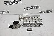 Aluminum Throttle Body BEFORE Chrome-Like Metal Polishing and Buffing Services - Aluminum Polishing - Throttle Body Polishing