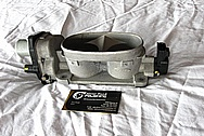 2007 Ford Mustang Aluminum Throttle Body BEFORE Chrome-Like Metal Polishing and Buffing Services