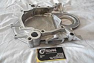 Aluminum Timing Cover BEFORE Chrome-Like Metal Polishing and Buffing Services / Restoration Services