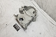 Aluminum V8 Engine Timing Cover BEFORE Chrome-Like Metal Polishing and Buffing Services - Aluminum Polishing