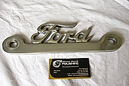 Aluminum Ford Trim Emblem BEFORE Chrome-Like Metal Polishing and Buffing Services