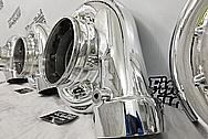 (4) 6,000 Horsepower PRI Show Aluminum Cast Turbo Housings AFTER Chrome-Like Metal Polishing and Buffing Services - Aluminum Polishing