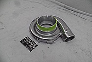 On 3 Performance Aluminum Turbo Housing BEFORE Chrome-Like Metal Polishing and Buffing Services - Aluminum Polishing
