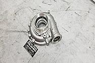 Borg Warner Aluminum Turbo Housing BEFORE Chrome-Like Metal Polishing and Buffing Services - Aluminum Polishing