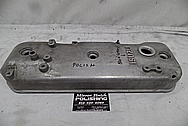 Isuzu Aluminum Valve Cover BEFORE Chrome-Like Metal Polishing and Buffing Services - Aluminum Polishing Services