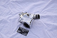 Mazda RX-7 Aluminum Water Pump Piece AFTER Chrome-Like Metal Polishing and Buffing Services