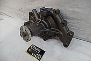 Steel Water Pump for 1965 Cadilliac BEFORE Chrome-Like Metal Polishing and Buffing Services / Restoration Services