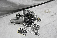 Aluminum Water Pump & Pulley BEFORE Chrome-Like Metal Polishing and Buffing Services / Restoration Services