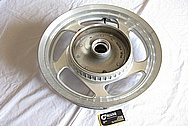 Aluminum Lowenhart Wheel Centercap BEFORE Chrome-Like Metal Polishing and Buffing Services